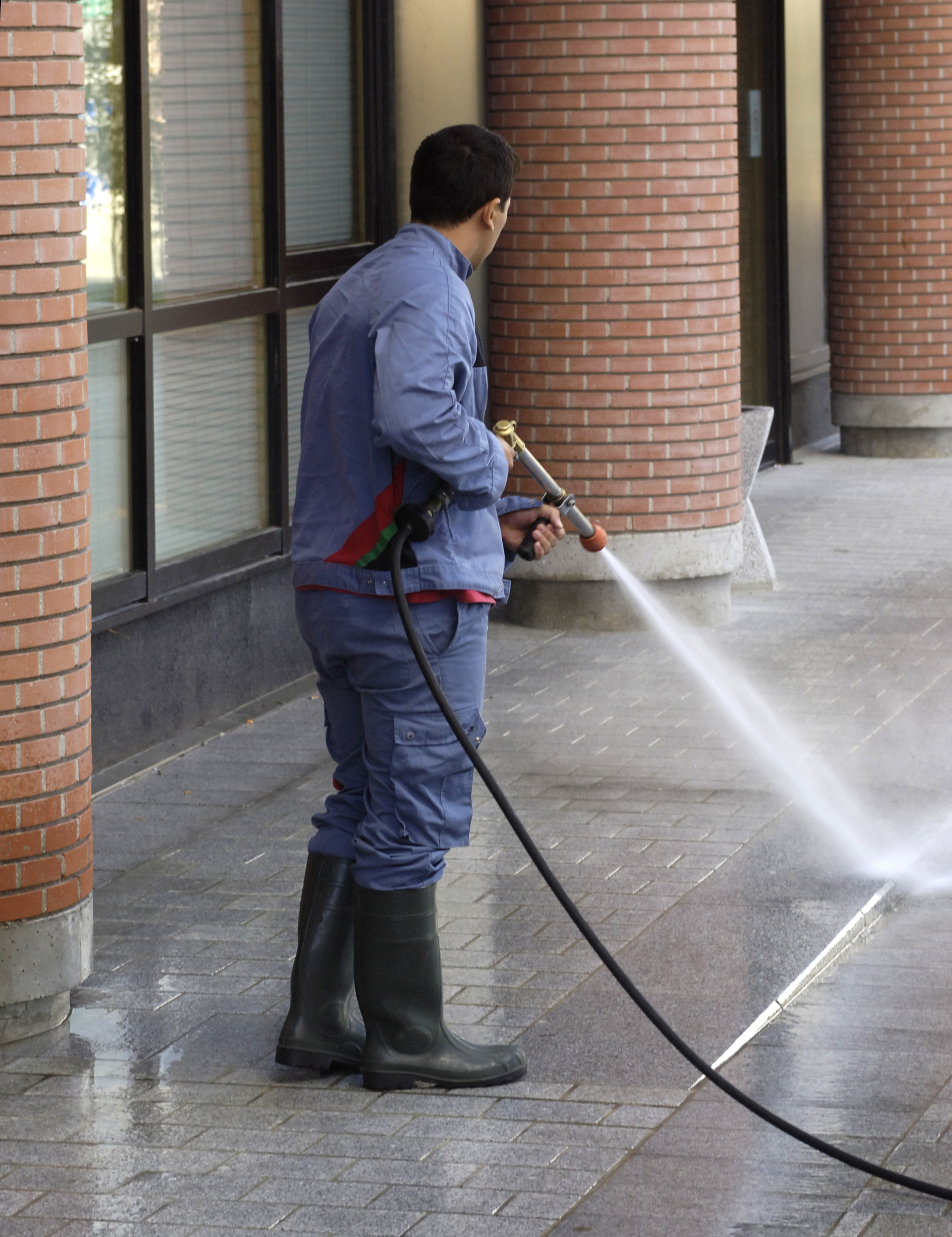 a man is cleaning with an high-pressure cleaner